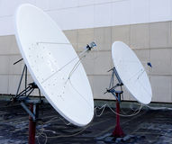 Sat antenna. Sat parabolic antennas on roof Royalty Free Stock Images