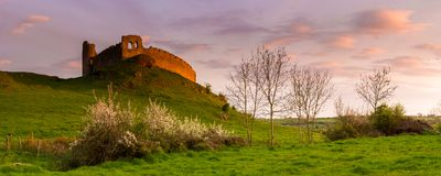 Sat on the Hill: another uncounted bath of light at sunset for that very Old Castle, Royalty Free Stock Photo