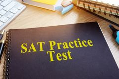 SAT Practice Tests on a desk. SAT Practice Tests with textbooks on a desk royalty free stock images