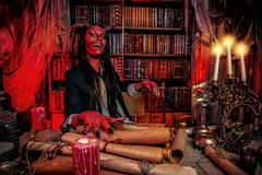 Satan diablo. Horned Devil in his home. Fantasy. Ancient style. Halloween Royalty Free Stock Photo
