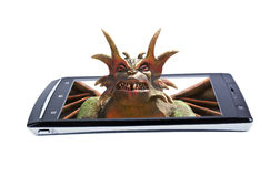 Satan on display smartphone. Collage Royalty Free Stock Images