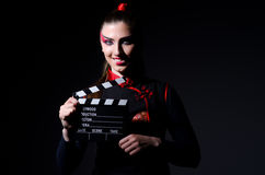 Satan halloween concept with movie. Clapper board Stock Image