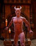 Satan vor einem Schrein Lizenzfreies Stockbild
