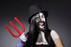 Satana woman with pitchfork Stock Photo