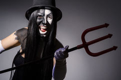 Satana woman with pitchfork Stock Photography