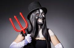 Satana woman with pitchfork Royalty Free Stock Photos