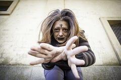 Satanic assaulting girl. Girl with satanic and gothic cross, halloween Royalty Free Stock Photography