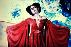 Satanic. Bloodthirsty female vampire rises from the coffin on the night cemetery Royalty Free Stock Photography