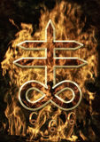 Satanic Cross. Background with fire and the number 666 Stock Photos