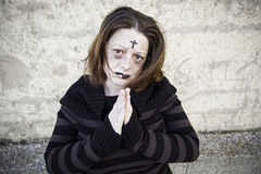 Satanic girl praying. Girl with satanic and gothic cross, halloween Stock Photos
