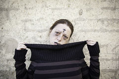 Satanic girl and sick. Girl with satanic and gothic cross, halloween Stock Photo
