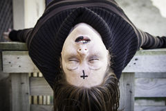 Satanic girl sleeping. Girl with satanic and gothic cross, halloween Royalty Free Stock Image