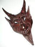 Satanic mask wooden. Evil Satanic Mask, pointed ears horned horns royalty free stock photos