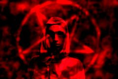 Satanic priest in red background. Horned Devil in his home. Fantasy. Ancient style. Halloween Royalty Free Stock Image