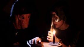 Satanic priests - pig and druid - performing dark ritual. 4K UHD stock video