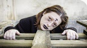 Satanic scared Girl. Girl with satanic and gothic cross, halloween Royalty Free Stock Photo