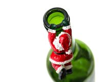 Satas Chimney. Christman Drinks Concept with Santa climbing into or out of empty bottle of Wine stock image