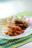 Satay. Few sticks of chicken and beef satay stock photo