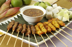 Satay. Spicy food being BBQ tradtional asian cuisine preparation, Satay (bamboo stick skewered barbequed meat royalty free stock image