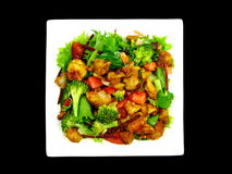 Satay Chicken Salad. Photo of satay chicken salad with steamed broccoli on white plate Royalty Free Stock Images