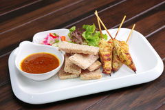 Satay Chicken , Sate Ayam with Peanut Sauce and bread , Asian sk royalty free stock images