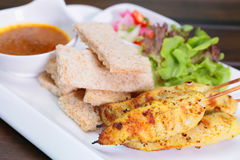 Chicken Satay ,Sate Ayam with Peanut Sauce and bread , Asian skewers famous food in Malaysia Indonesia and Thailand royalty free stock photos