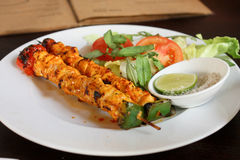 Satay Chicken Skewer. A photo showing a local Vietnamese dish, satay chicken on a skewer with pepper salt Stock Image