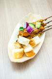 Satay chicken with toast. Royalty Free Stock Images