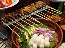 Satay and condiments. Two types of satay and condiments royalty free stock images