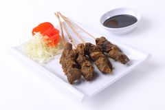 Satay Indonesia food on white plate. Beef Satay creation from Indonesia food on white plate white background stock photo