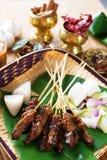Satay Malay food. Beef satay, roasted meat skewer Malay food. Traditional Malaysia food. Hot and spicy Malaysian dish, Asian cuisine Royalty Free Stock Image