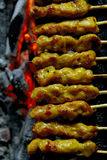 Satay; meat on thin bamboo sticks Royalty Free Stock Image