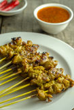 Satay and Peanut Sauce. Asian food Satay on a rough texture table stock images