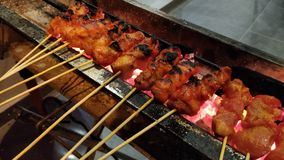 Satay or sate. Satay, or sate in Indonesian spelling, is a dish of seasoned, skewered and grilled meat, served with a sauce. It is a dish of Southeast Asia stock photo