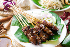 Satay. Or sate, skewered and grilled meat, served with peanut sauce, cucumber and ketupat, Malaysia or Indonesia food. Traditional Malay food. Hot and spicy royalty free stock photo