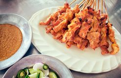 Satay, Seasoned and Skewered Pork, served with Sauce. royalty free stock images