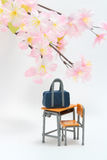 Satchel and cherry blossoms on white background. Royalty Free Stock Image