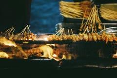 Sate or Satay on fire. Night Street Market, street food stock image