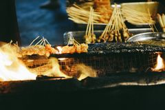 Sate or Satay on fire. Night Street Market, street food royalty free stock images