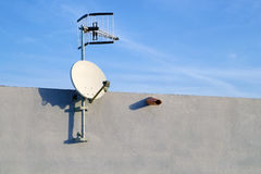 Satelite is attached to the wall of the house . Stock Image