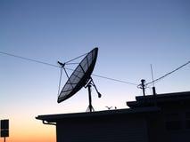 Satelite Dish. On top of dwelling Royalty Free Stock Photos
