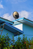 Satelite dish is attached to the wall. Of the house Stock Image