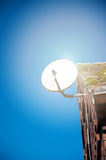Satelite dish. Satelite is attached to the wall of the house Royalty Free Stock Image