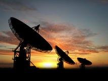 Satelite Dishes. Three satelite dishes over sunset Stock Photos