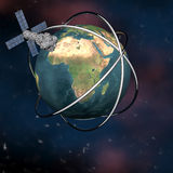 Satelite sputnik orbiting earth. In space Royalty Free Stock Image