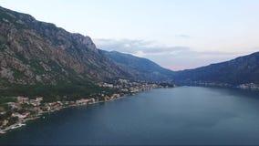 Satellietbeeld van de stad Dobrota in de Baai van Kotor Montenegro stock video