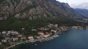Satellietbeeld van de stad Dobrota in de Baai van Kotor Montenegro stock footage