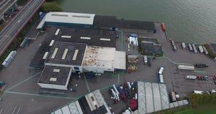 Satellietbeeld van pakhuizen in de haven, Dordrecht, Nederland stock footage