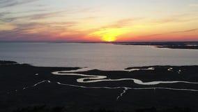 Satellietbeeld van zonsondergang over de baai van Delaware stock footage