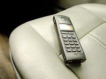 Satellit- telefon på Front Seat Royaltyfria Bilder